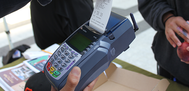 Markets use a wireless POS device to swipe the customer's EBT card.