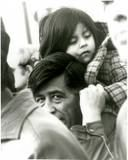 Cesar Chavez with a child on his shoulders